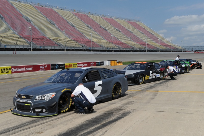Cars are stopped on pit road to check tire pressures during the 2015 NASCAR Sprint Cup Series Rules Test at Michigan International Speedway on August 18, 2014 in Brooklyn, Michigan. (Photo: Robert Reiners/NASCAR via Getty Images)