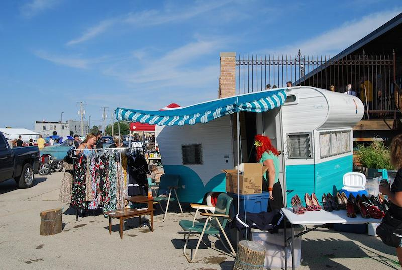 This vendor was selling vintage clothing and accessories from an old-fashioned, turquoise-and-white travel trailer.