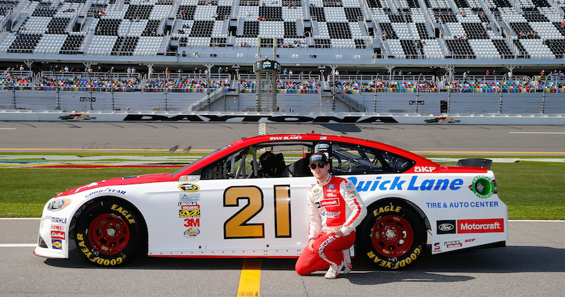 Ryan Blaney, driver of the #21 Motorcraft/Quick Lane Tire & Auto Center Ford, poses with his car after qualifying for the NASCAR Sprint Cup Series Daytona 500 at Daytona International Speedway on February 14, 2016 in Daytona Beach, Florida.  (Photo by Jonathan Ferrey/NASCAR via Getty Images)