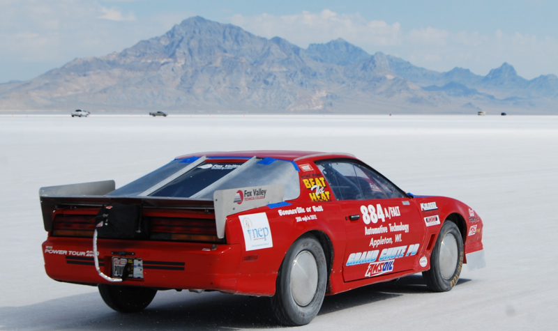 In the car blasting off down the long course at Bonneville Speedway.